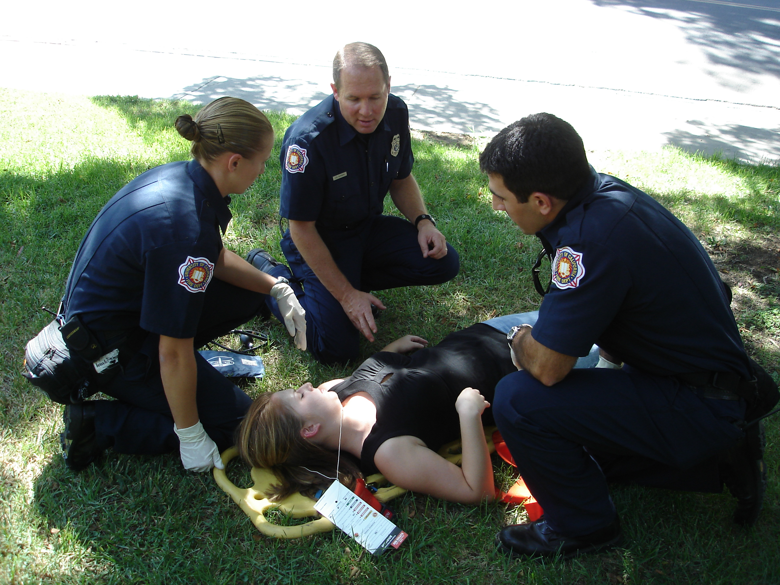 """UC Davis Firefighters giving medical care"""