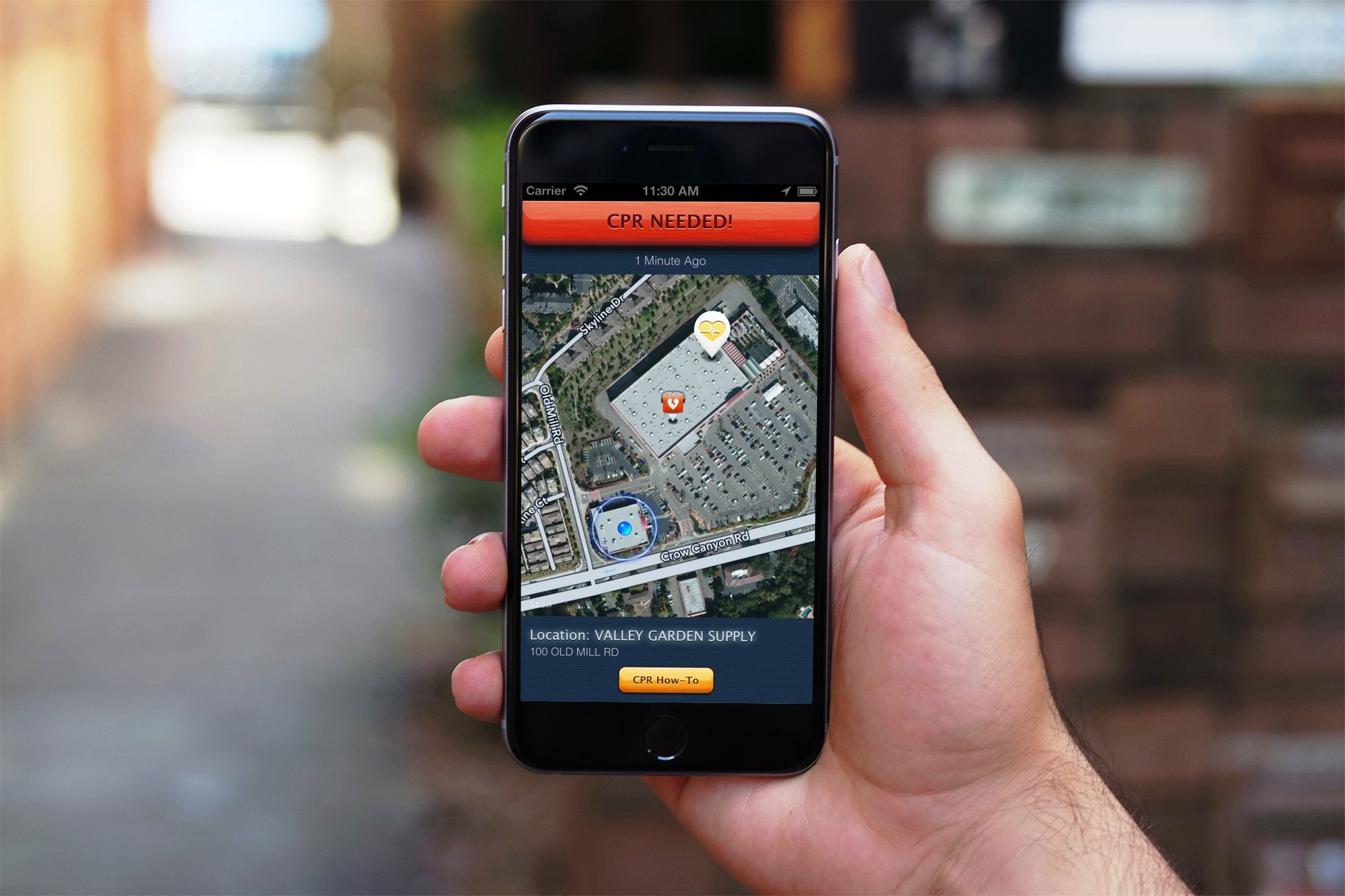 """Hand holding phone with PulsePoint on screen"""