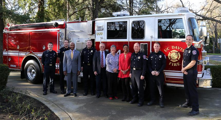 Eleven breakfast guests, including the new fire engine! From left: firefighter Kyle Dubs, Assistant Fire Chief Jeff Seaton, Chancellor Gary S. May, Fire Chief Nate Trauernicht, Provost and Executive Vice Chancellor Ralph J. Hexter, Vice Chancellor Kelly Ratliff, LeShelle May, Capt. Joe Newman, firefighter Ryan Tooley and Assistant Fire Chief Nathaniel Hartinger. (Grant Nejedlo/UC Davis)
