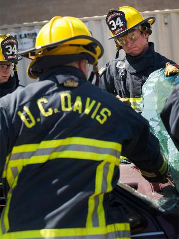 Student firefighter Dominic Burke trains to extricate victims from cars. (Karin Higgins/UC Davis)