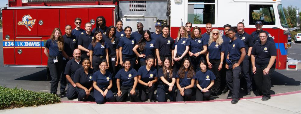 A graduating class from the UC Davis EMT program stands in front of Engine 34.