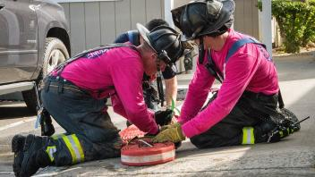 Firefighter wearing pink shirts