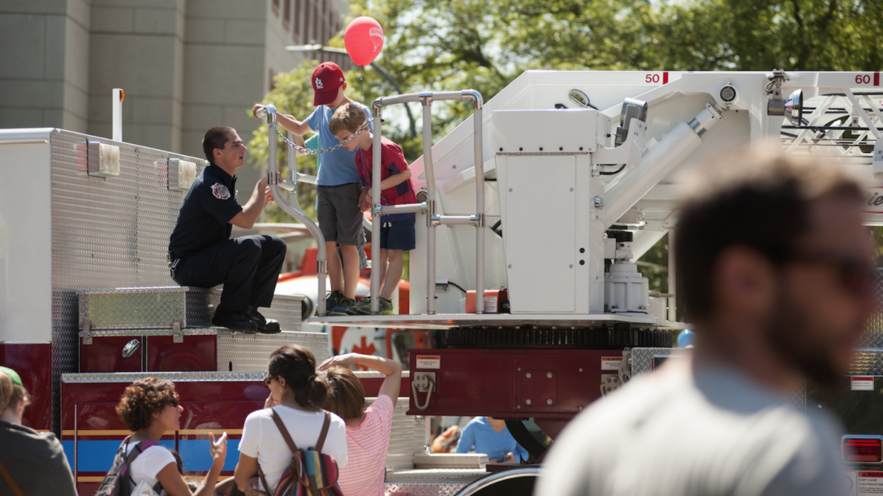 UC Davis Student Firefighter shows children around Truck 34 at Picnic Day 2016.