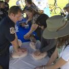 UC Davis Firefighters teach Hands-Only CPR at the UC Davis Farmers Market.
